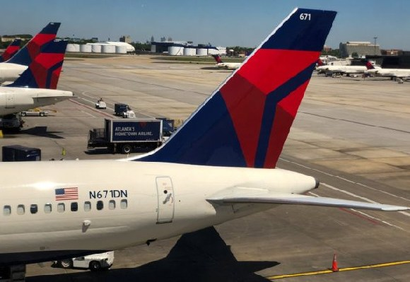 Planes from Delta Airlines, which is being accused of negligence, sitting on the tarmac in Atlanta
