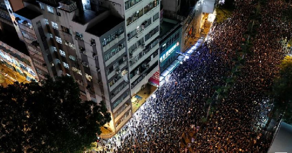Protesters attend a demonstration demanding Hong Kong's leaders step down, withdraw extradition bill