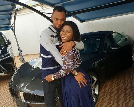 Fans stunned as Rev Obofour places hand on wife's backside