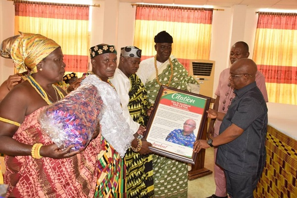 Volta Regional Minister, Dr. Archibald Yao Letsa receiving a citation being presented to him