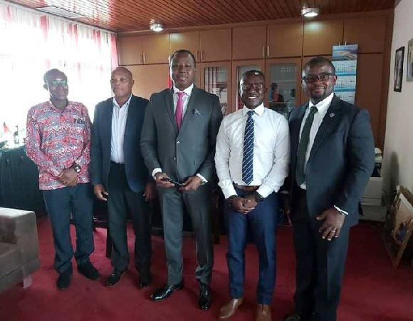 CHRAJ Commissioner Joseph Whittal (M) with some officials on the project