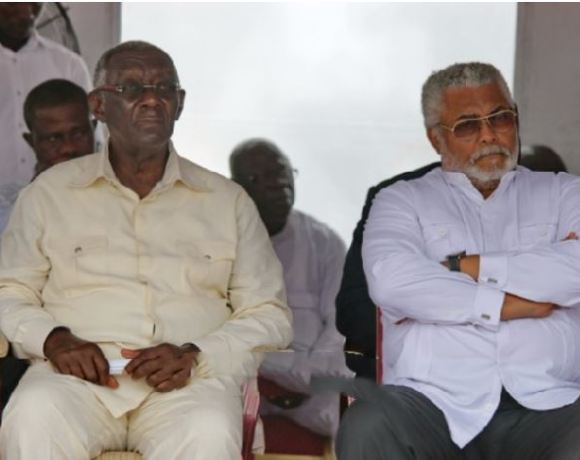 J.A Kufuor and J.J Rawlings sit together at an event