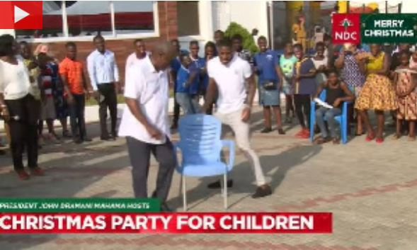 Mahama on musical chairs with son