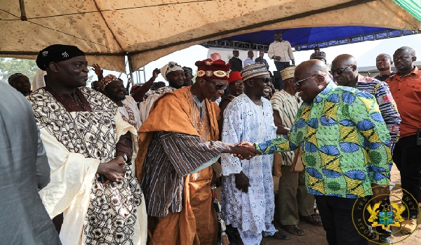 President Akufo-Addo shaking hands with the chief of Ngleshie Amanfro