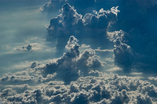 Photo 86917 Rising clouds from a window of a plane from
