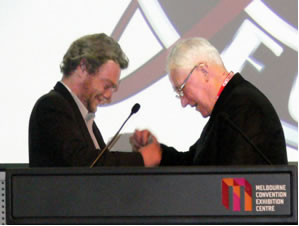 Hamish accepts the inaugural Norma K Hemming award from Bill Wright