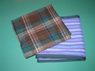 Green plaid and purple striped blankets