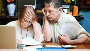 Senior Couple Going Over Bills And Experiencing Financial Stress Ashar Group
