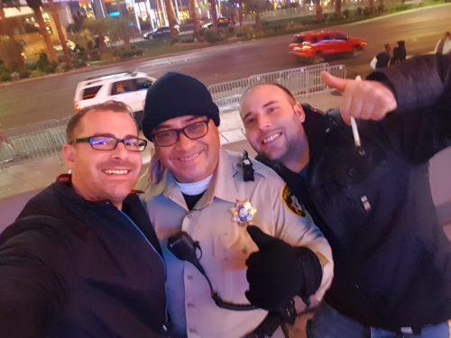 Happy Police posing with drunk us Las Vegas