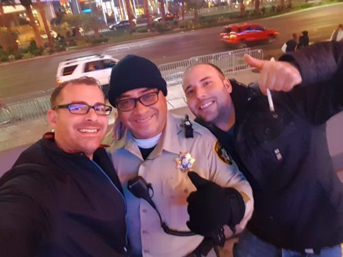 Happy Police posing with drunk us Las Vegas