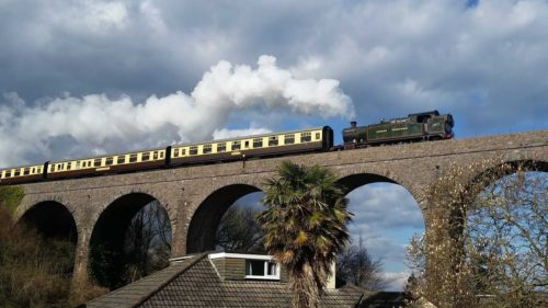 Steam train, clouds, viaduct, house, palm tree
