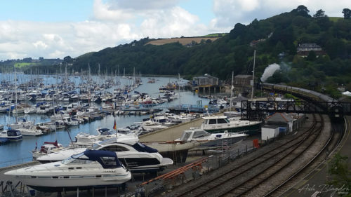 Boats, river, blue sky, steam train,