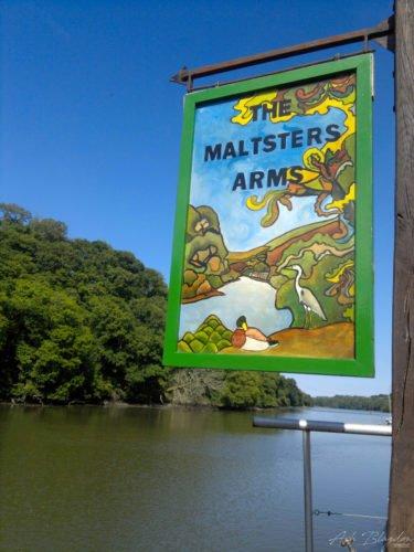 A pub sign over a river