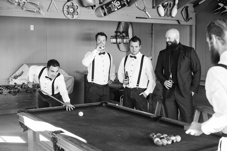 groomsmen getting ready, groomsmen playing pool, backyard wedding