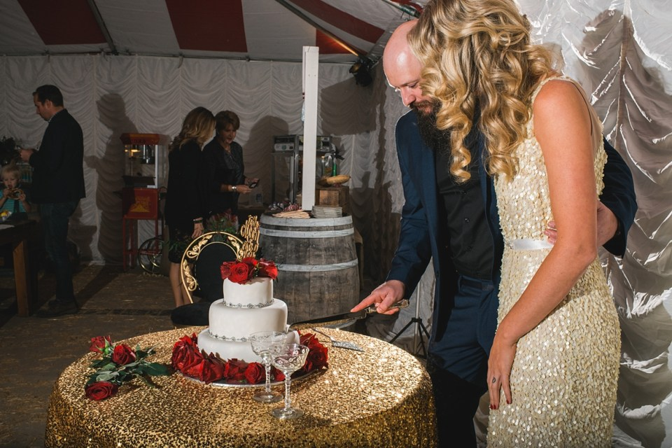 gold sequin cake table, white fondant cake with flowers, to the moon and back cake topper, circus wedding