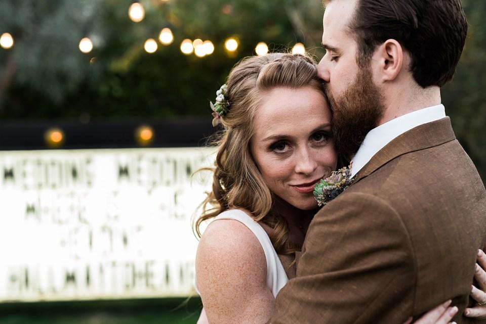 groom kissing bride