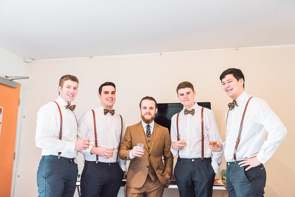 groom with groomsmen taking shots