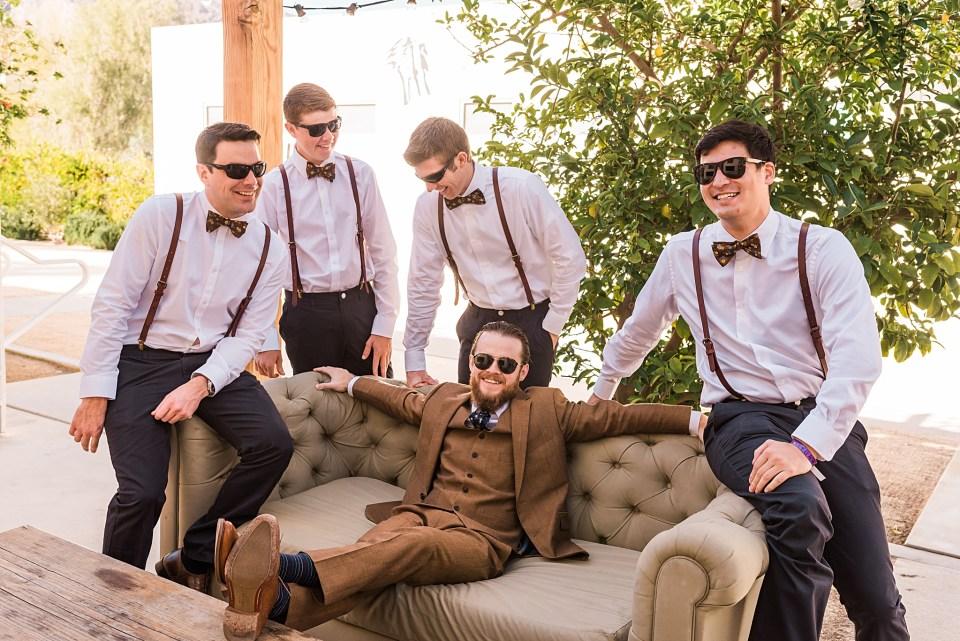groom having fun with groomsmen