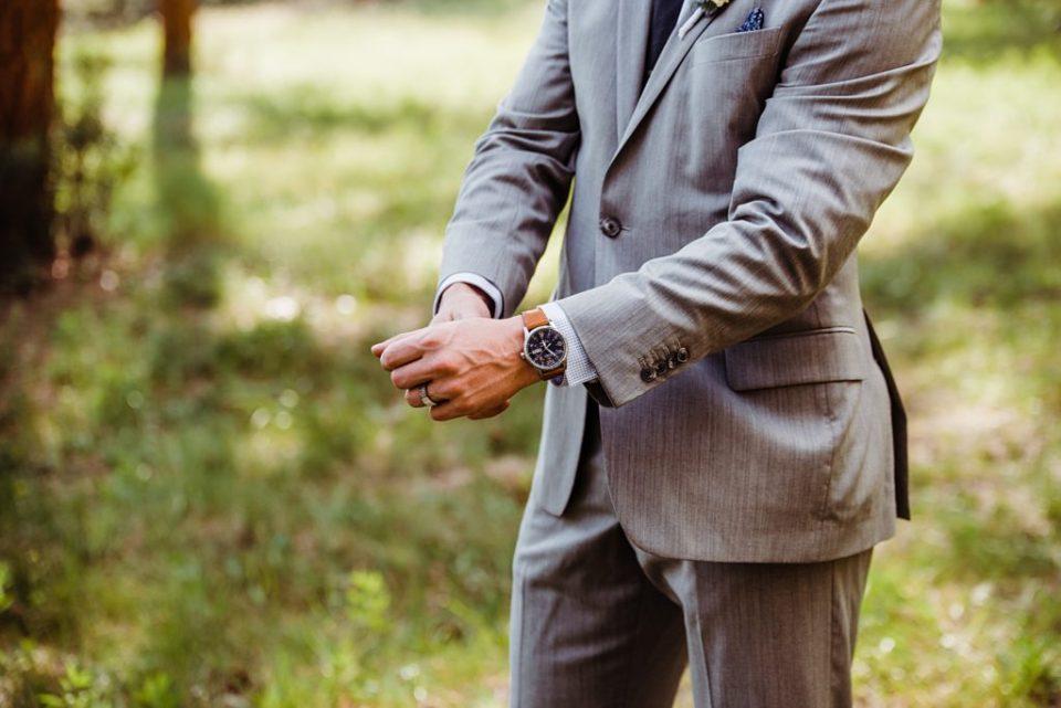groom adjusting jacket