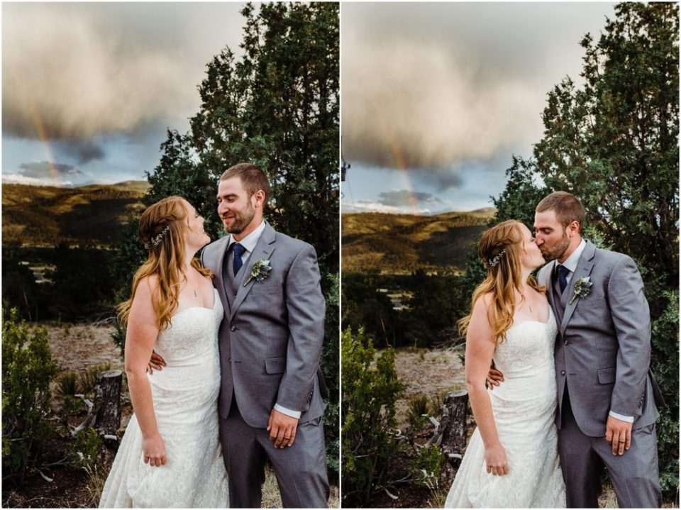 bride and groom with mountain rainbow