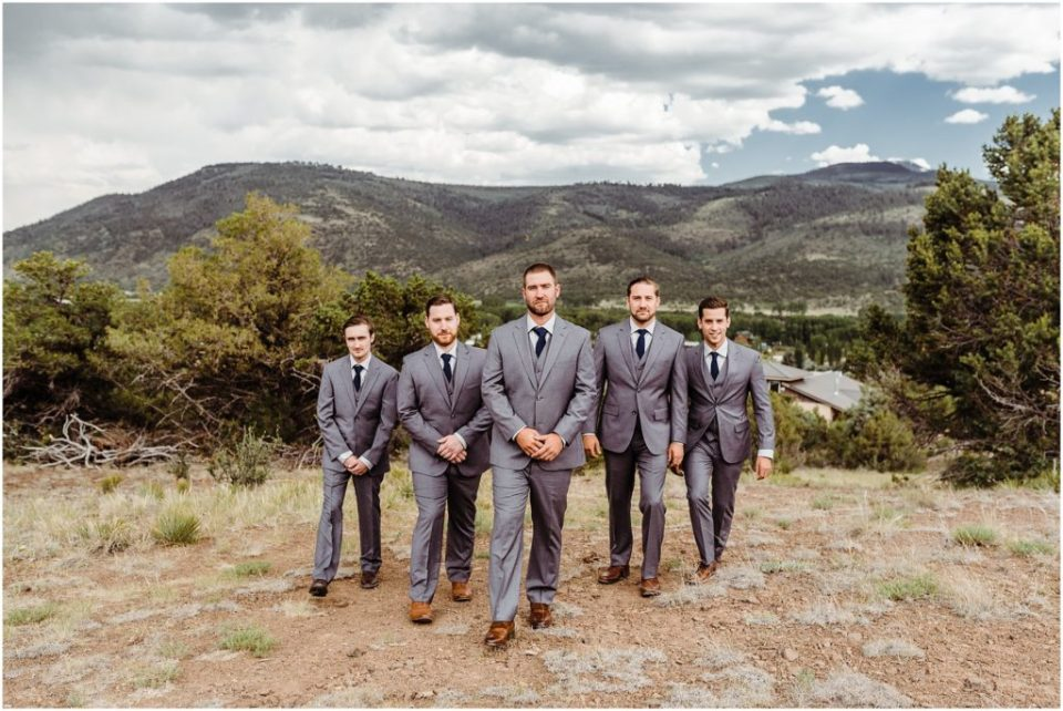 mountain groom with groom's party