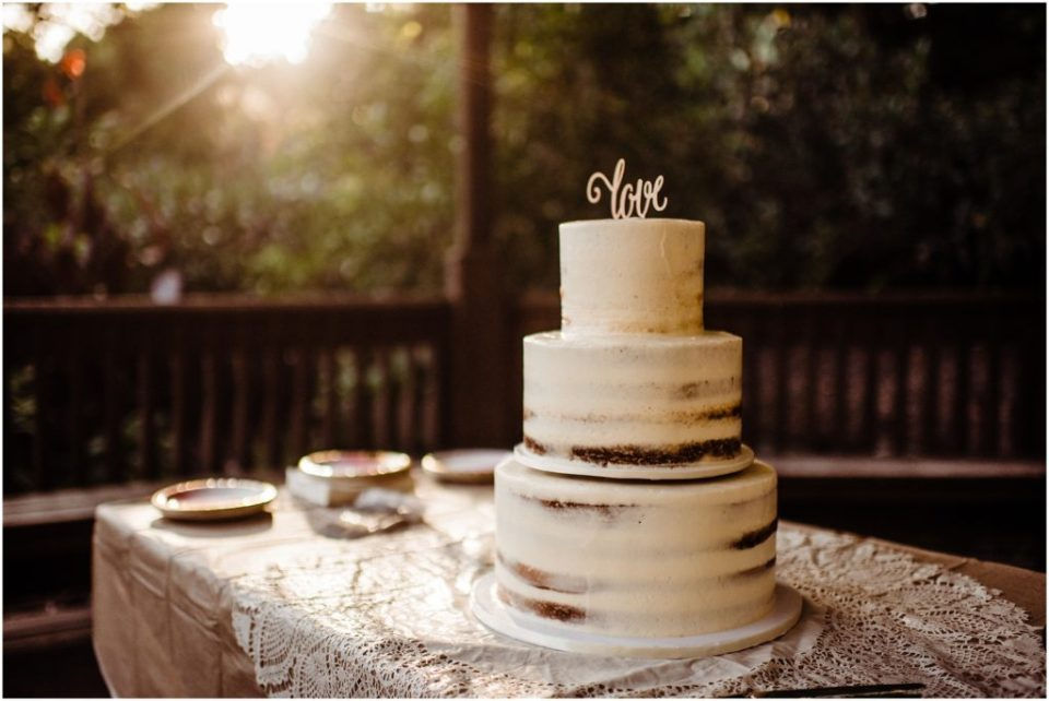 naked wedding cake with love topper