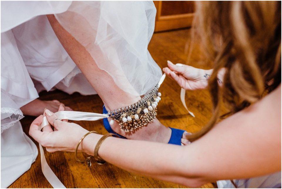 bride putting heels on
