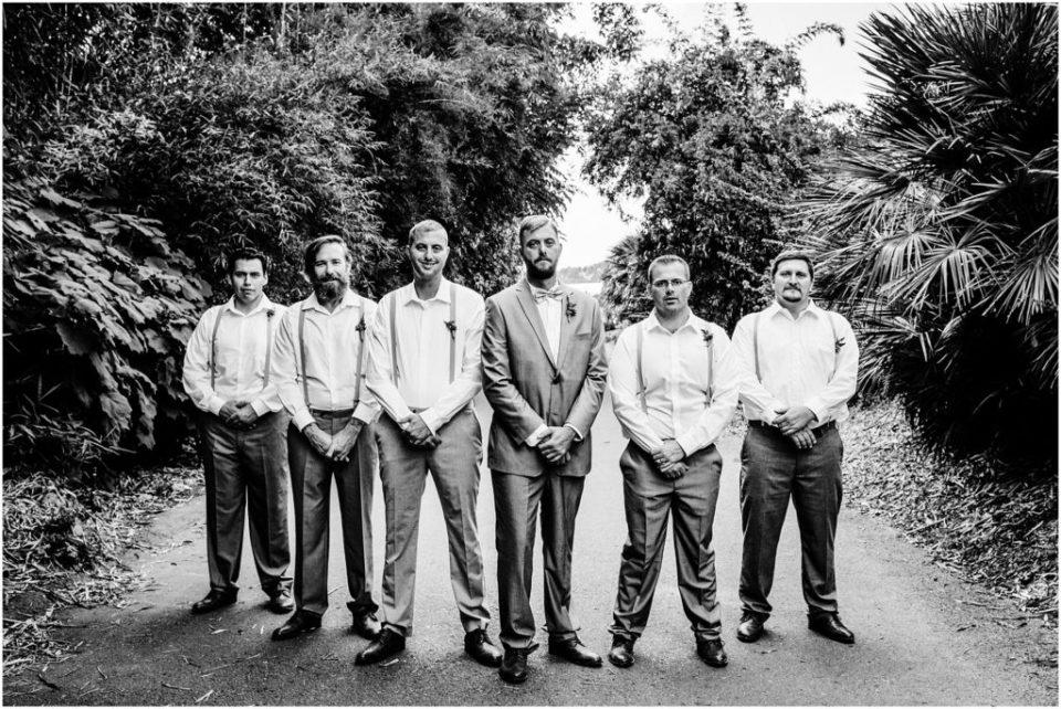 stoic black and white groomsmen party portrait