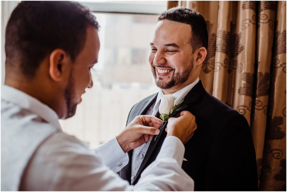 best man helping brother get ready