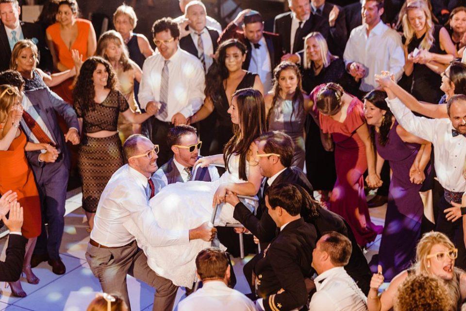 hora at jewish wedding reception at skirball center