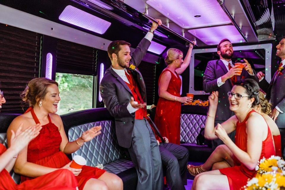 wedding party in the limo party bus