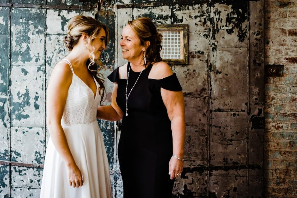 bride with mom before wedding