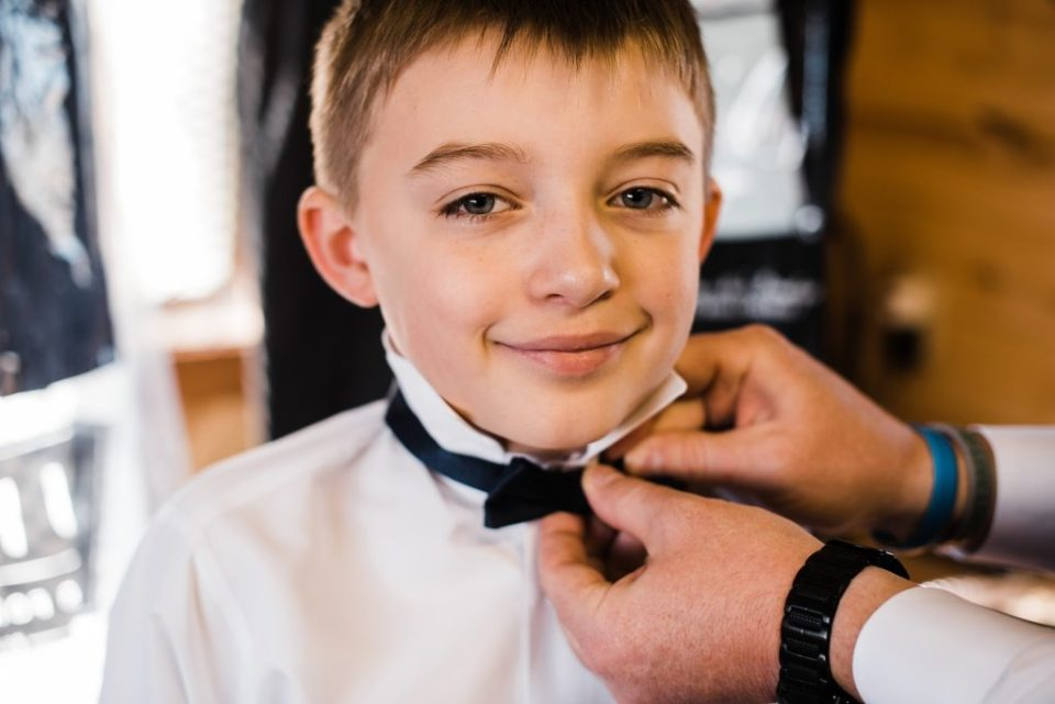 ring bearer getting ready at rustic lace barn