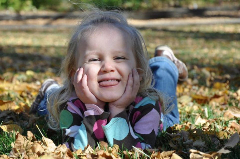 silly girl in the fall leaves