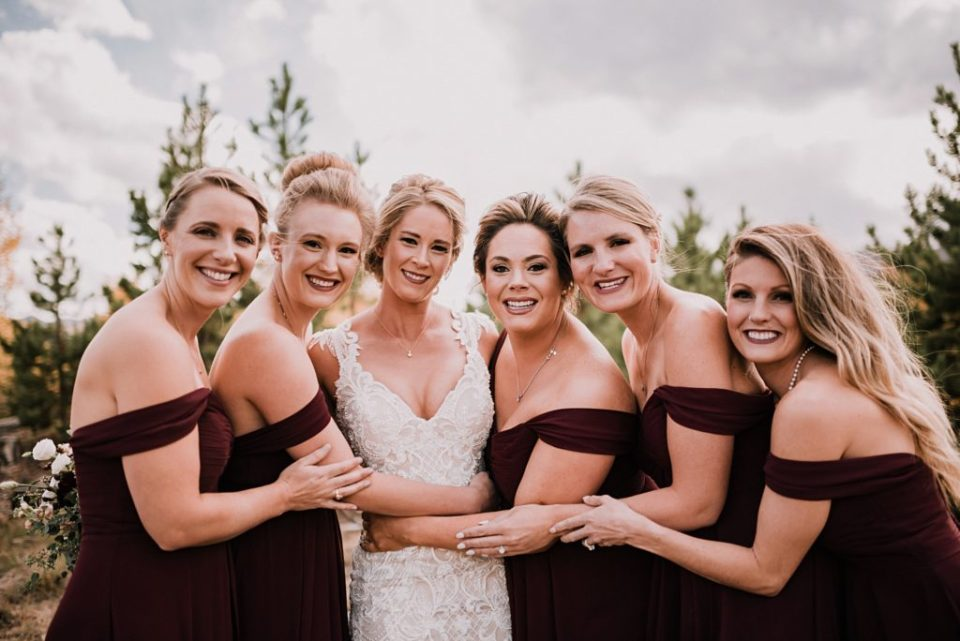 wedding party photos in the fall leaves in breckenridge