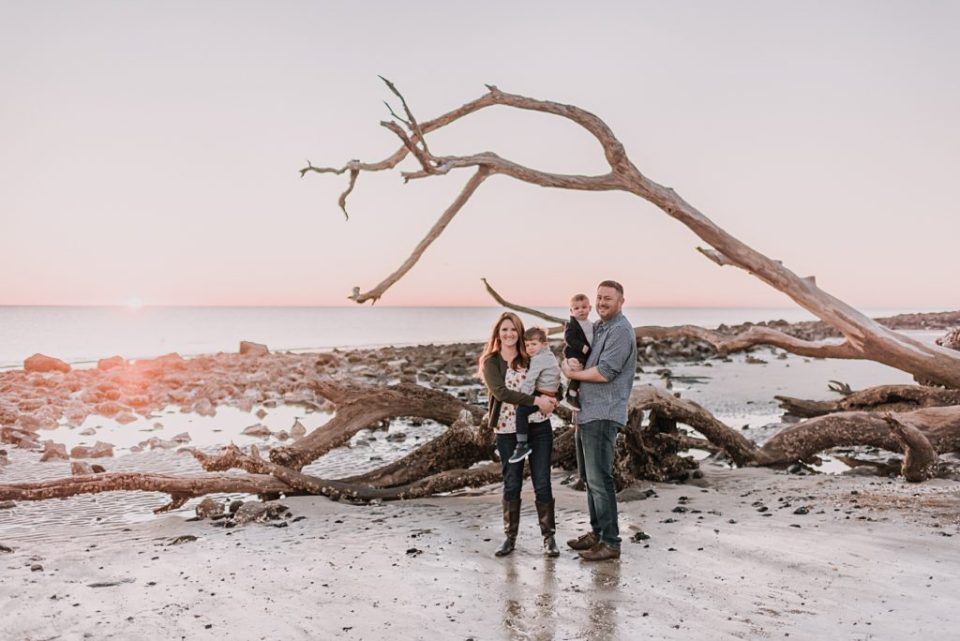family with the driftwoods on the beach