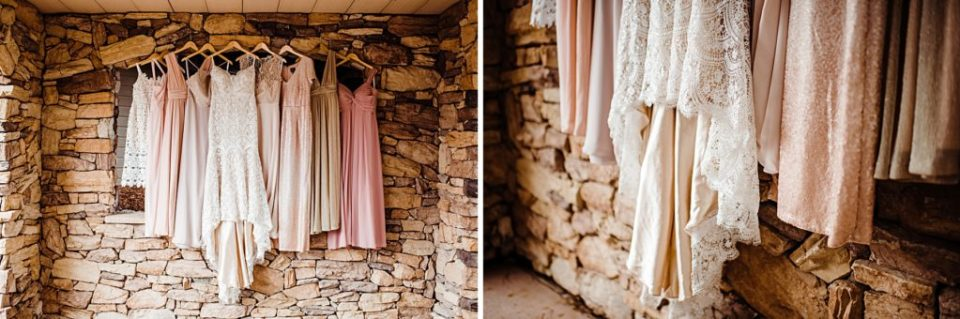 bridesmaids dresses hanging up with brides dress