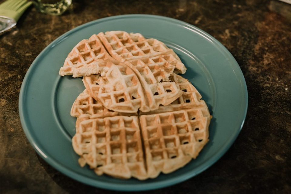homemade waffles on a green plate