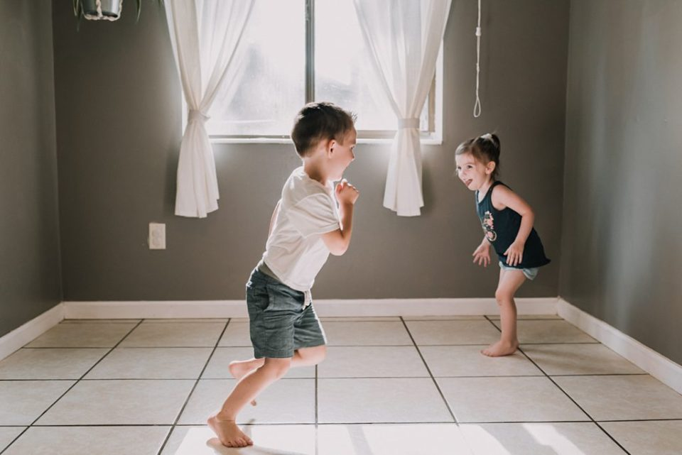 two kids playing in the kitchen