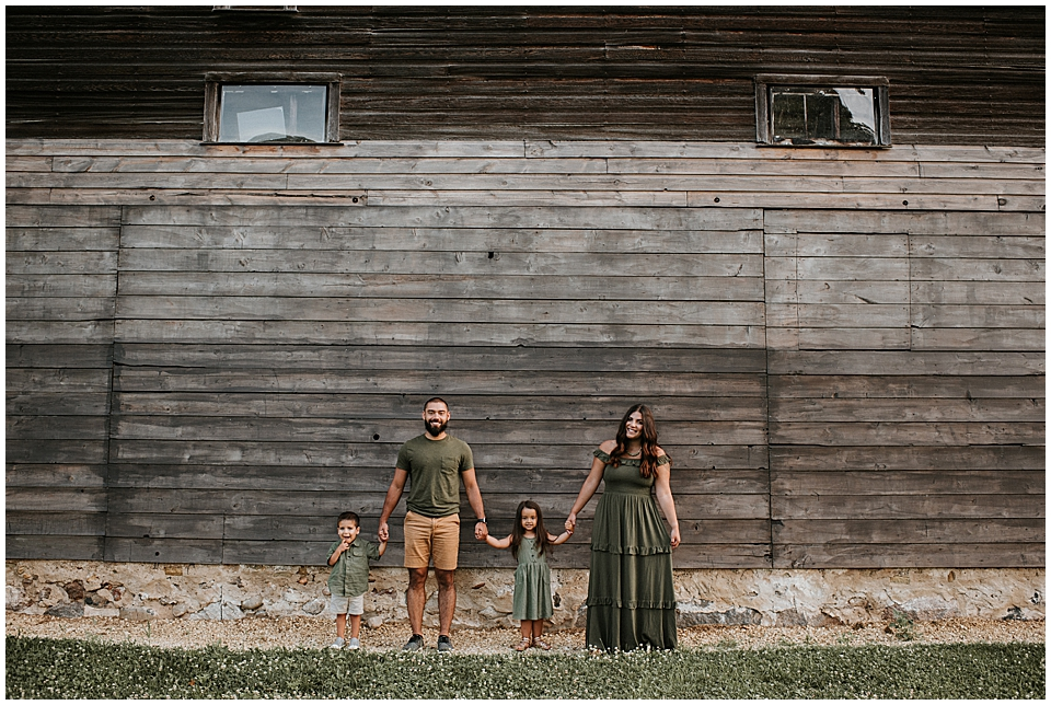 family session in front of old barn