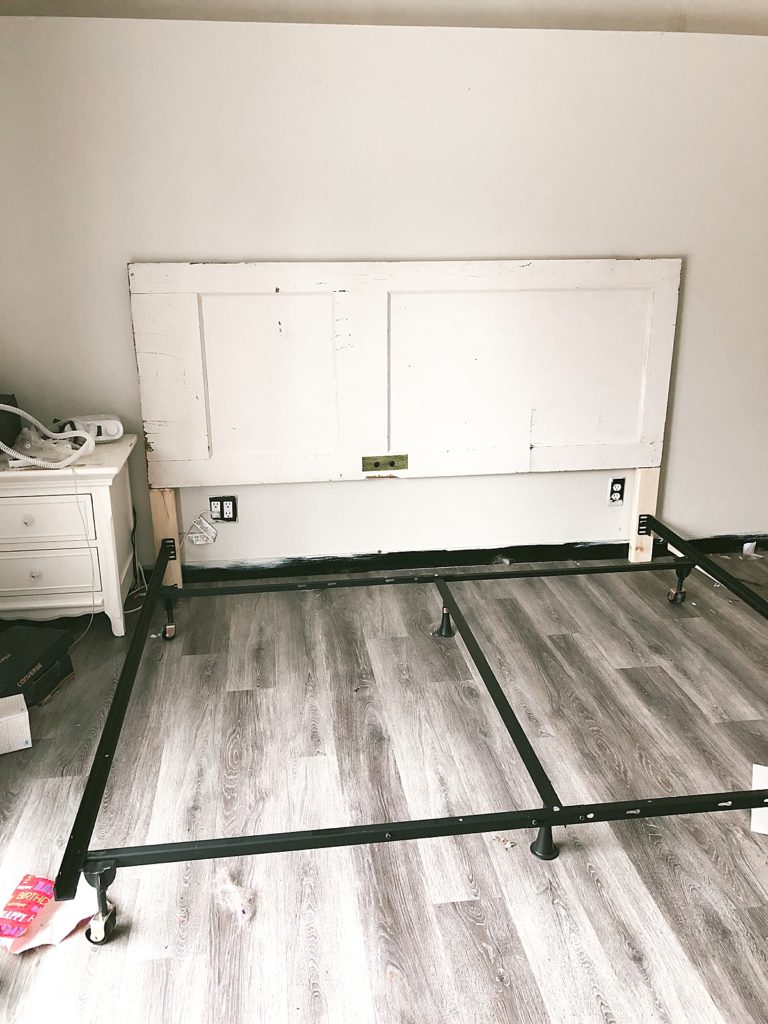 attaching bed frame to old door to use as a headboard