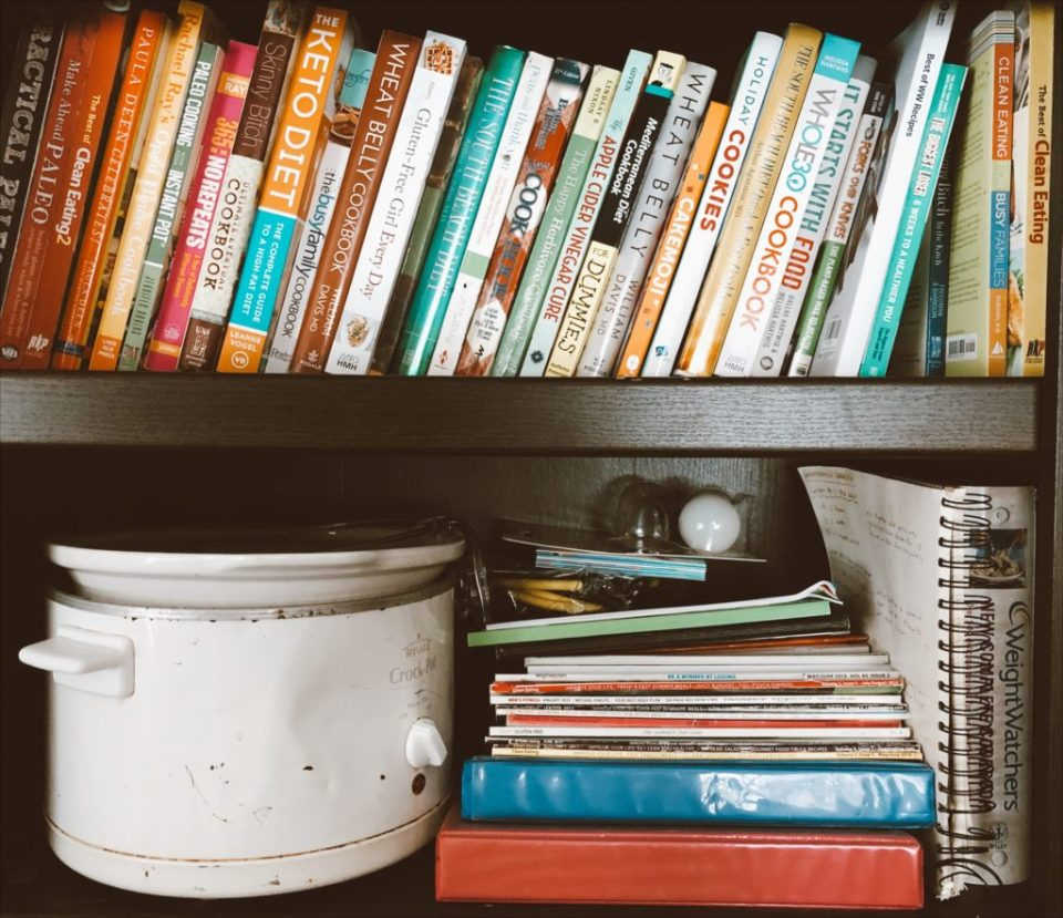 bookshelf filled with weight loss books