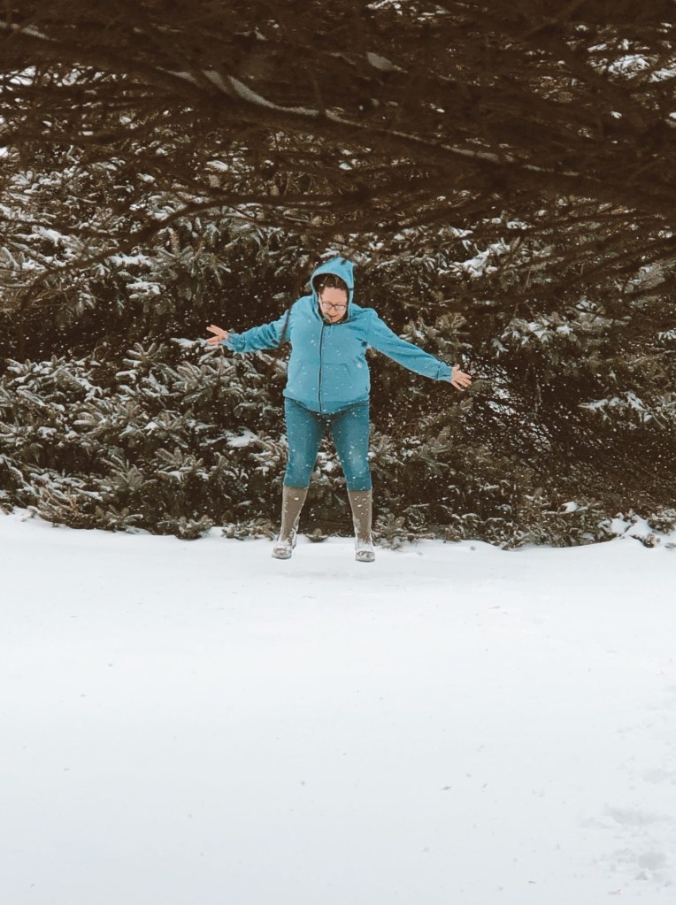 Wisconsin mom jumping in the snow find joy