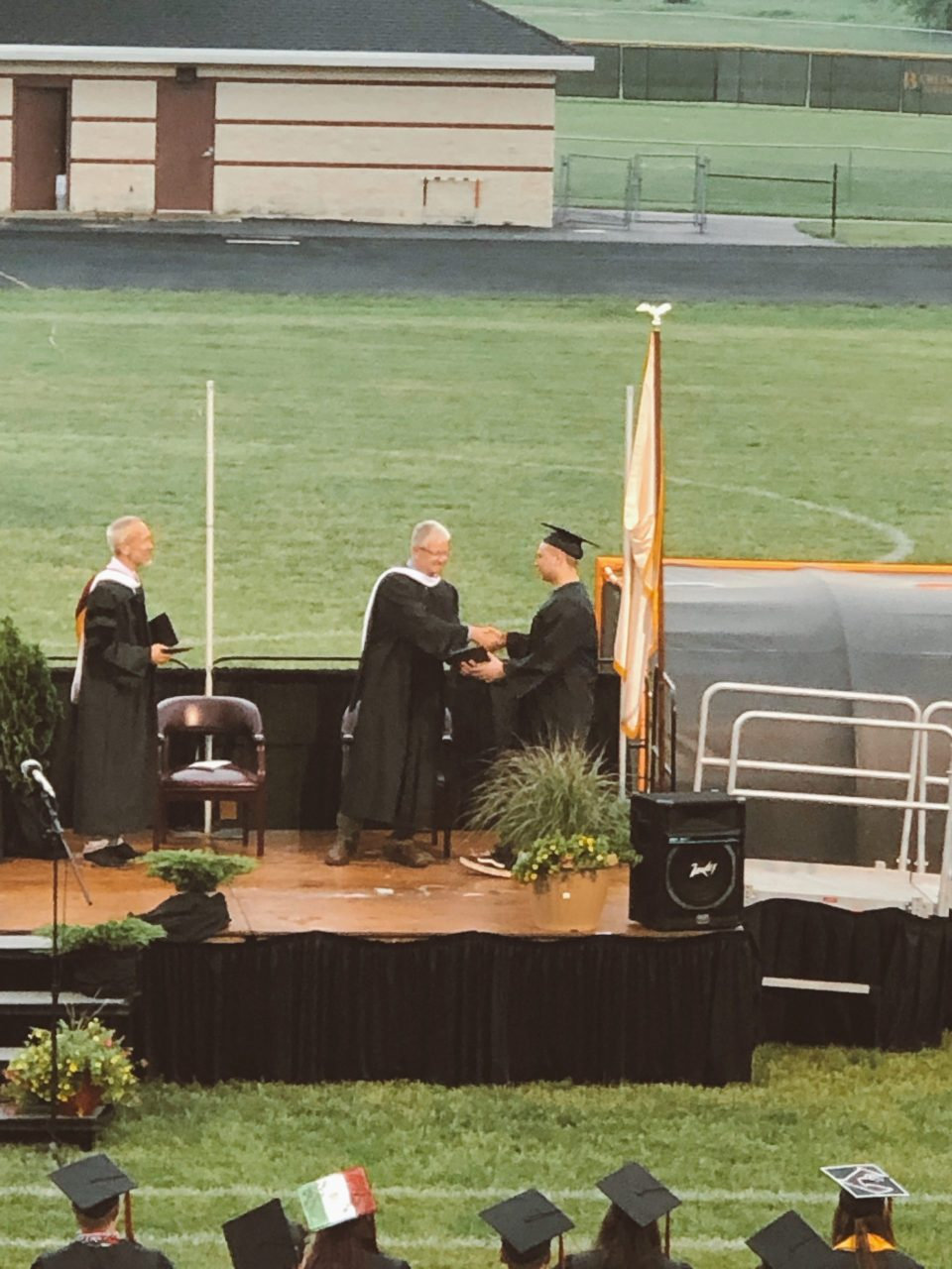senior receiving diploma at graduation ceremony
