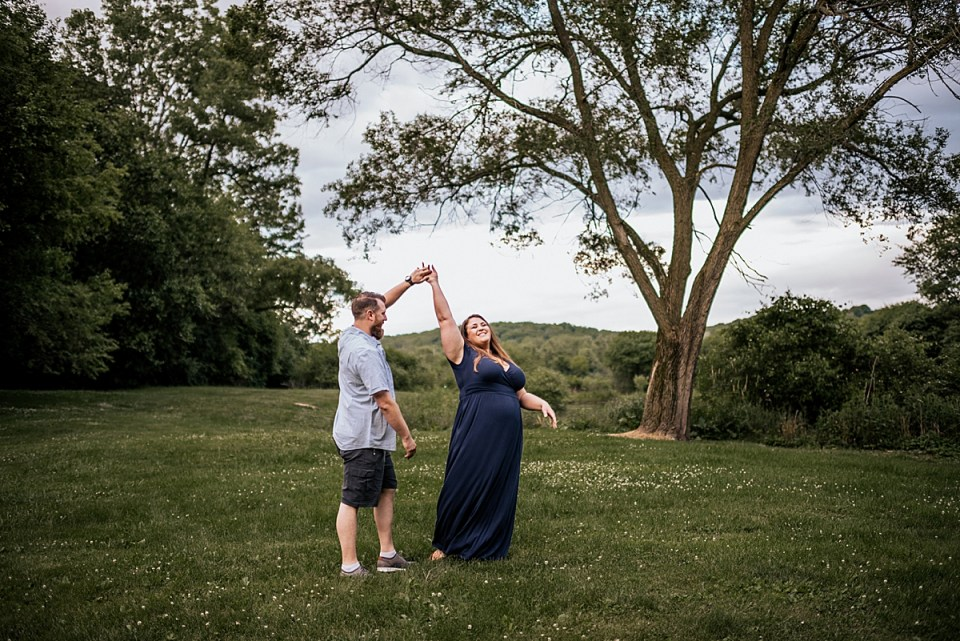 mom and dad dancing in a field