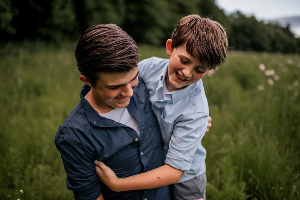brothers playing together during elkhorn family session