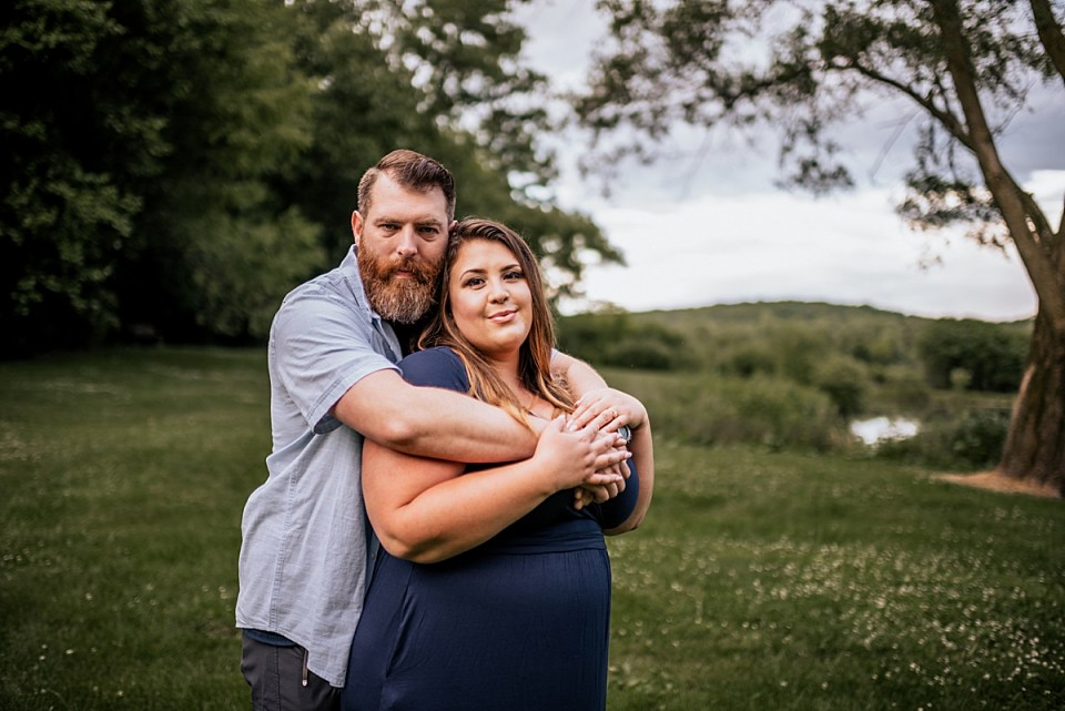 husband hugging wife from behind elkhorn couples photography