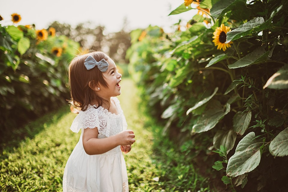 little girl excited to see sunflowers