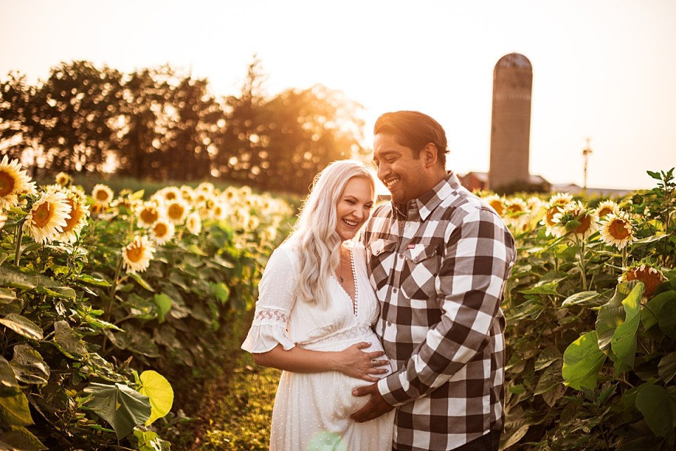 happy couple during summer maternity photo session