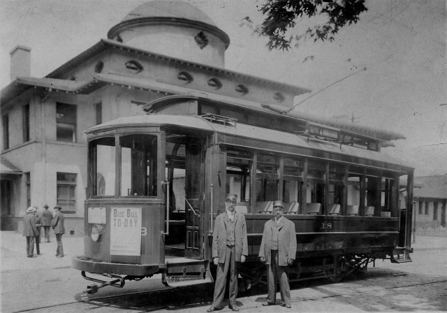 Asbury Whisnant and Henry Thompson with streetcar at Asheville's Southern Railway Depot, ca. 1905. Collection of Richard and Elaine Whisnant.. Image enhancement by Evan Whisnant.